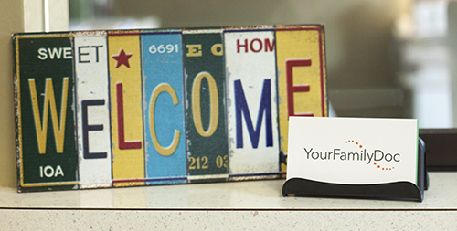 A welcome sign on the front counter.